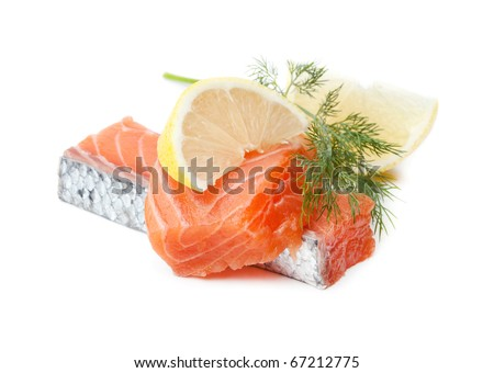 Two salmon pieces with lemon and dill. Isolated on white - stock photo