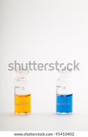 Two sample vials for chromatography filled each with one milliliter of color liquid. Isolated on white. Please see my portfolio to find more similar images - stock photo