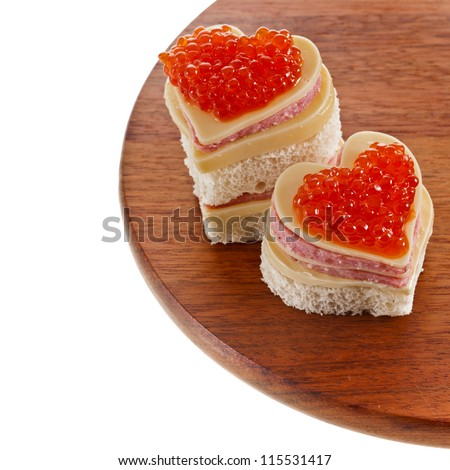 two sandwich with red caviar in the form of a heart isolated on white - stock photo