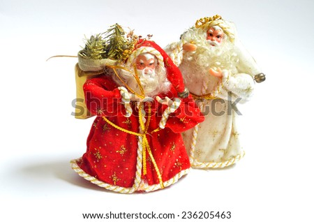 Two Santa Claus with christmas gifts on white background - stock photo