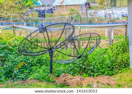 two satellite dishes mounted on the ground - stock photo