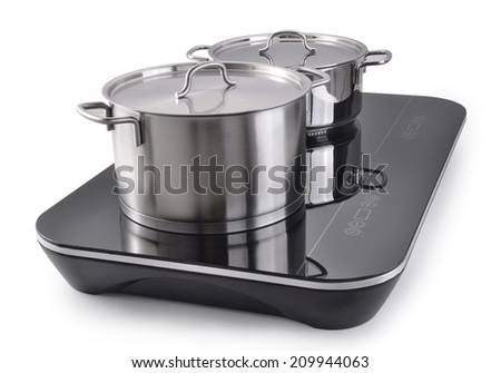 Two sauce pans in Induction cooker  - stock photo