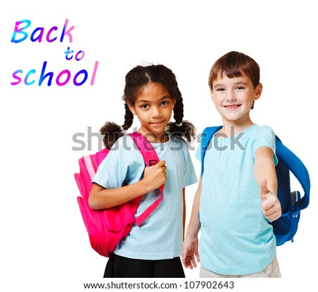 Two school kids in blue t-shirts with backpacks - stock photo