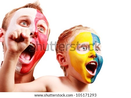 Two screaming fans - Poland Ukraine with painted faces in national colors - stock photo