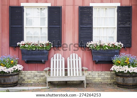 two seated wooden chair with classic vintage pale pastel tone wall and windows  - stock photo