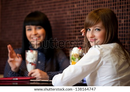two semen sit in cafe - stock photo