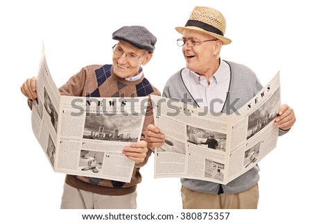 Two senior gentlemen reading the news together and smiling isolated on white background - stock photo