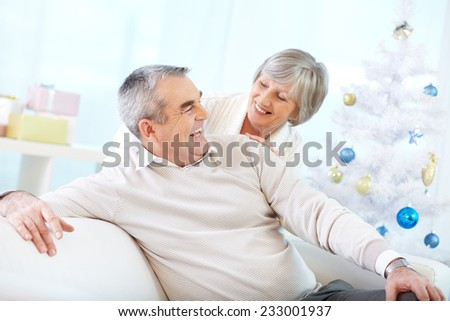 Two seniors laughing at home - stock photo