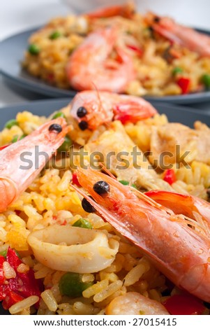 two servings of traditional spanish paella - stock photo