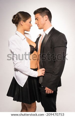 Two Sexy Young Couple in Fashion Portrait, Isolated on Gray Background - stock photo