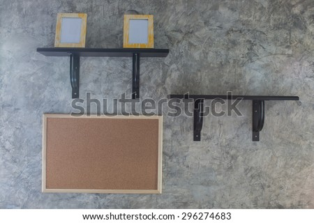 Two shelves on the wall of cement. - stock photo