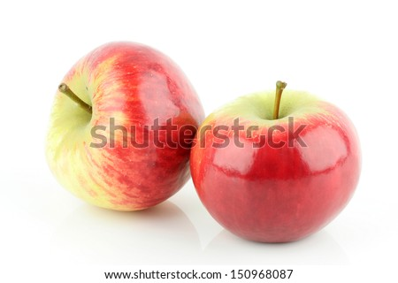 Two shiny fresh red Elstar apples (Malus domestica), on a white background. - stock photo