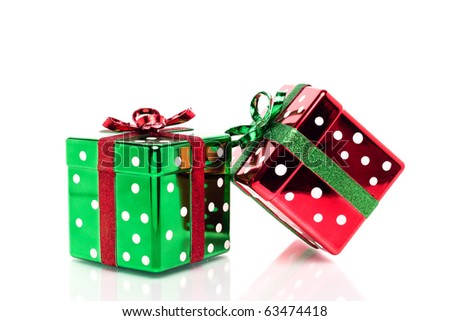 Two shiny polka dot red and green Christmas presents. - stock photo
