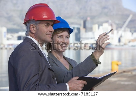 Two shipping engineers in the harbor - stock photo