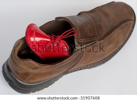 Two shoes, big and small - stock photo