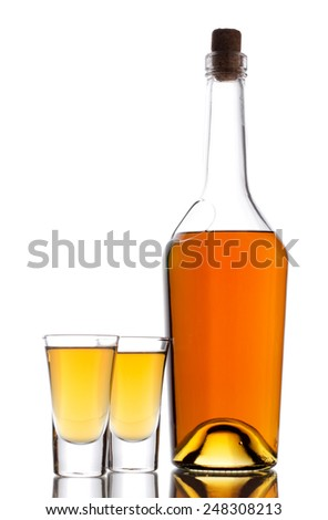 Two shot of whisky and bottle on a white - stock photo