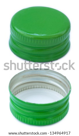 Two sides of a green metal bottle cap, seen from a slightly high angle. Isolated on white background. - stock photo