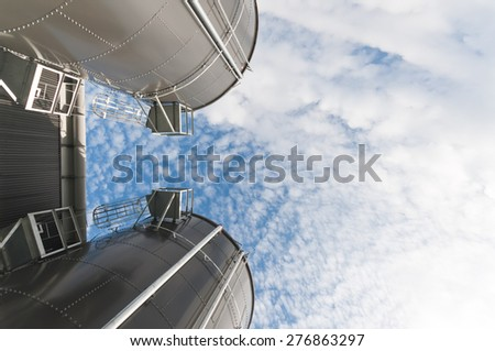 Two silo and the sky - stock photo