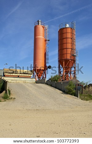 Two silos against sky - stock photo