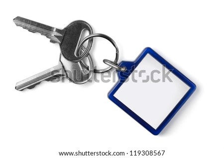 Two silver keys with blank key fob isolated on white - stock photo