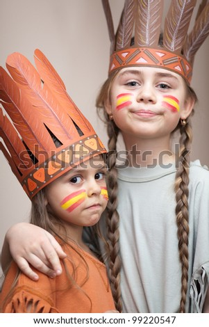 Two sisters dressed as Indians - stock photo