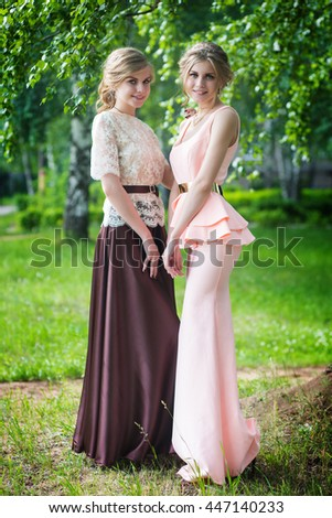 two sisters in nature - stock photo