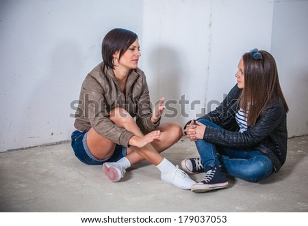 Two sisters lovely stirring in the unfinished house - stock photo