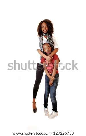 Two sisters, one small and one big showing there love to each other for white background in the studio. - stock photo