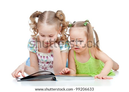 two sisters reading a book together - stock photo