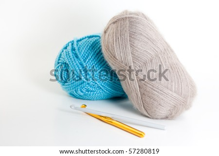 Two skeins of yarn with a crochet hook - stock photo