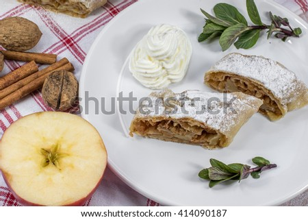 Two Slices Homemade Apple Strudel on Plate with Whipped Cream, Mint and Apple - stock photo