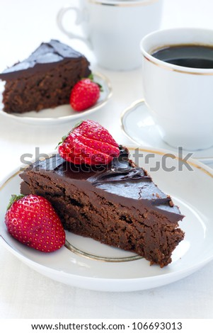 Two slices of a chocolate pie and two cups of coffee - stock photo