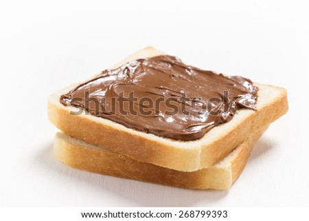 Two slices of bread with chocolate hazelnut spread - stock photo