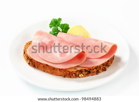 Two slices of ham on bread - stock photo