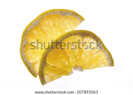Two slices of ugli (citrus fruit), elevated view, close-up - stock photo