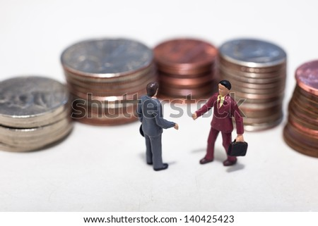 Two small buisness men making a deal - stock photo