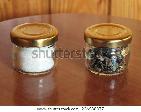 Two small glass jars with sugar and tea       - stock photo