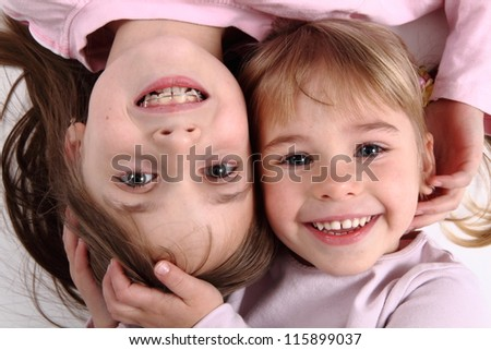 two small sisters portrait - stock photo