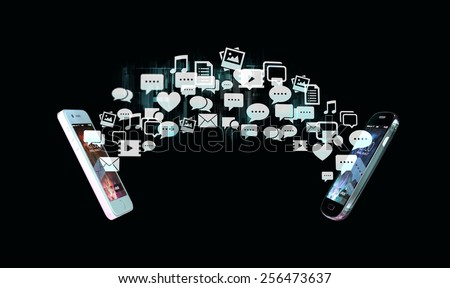 Two smart phones exchanging messages represented as flow of social media related icons.  - stock photo