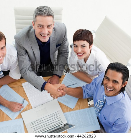 Two smiling business people greeting each other in a meeting - stock photo