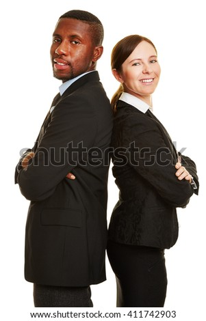 Two smiling business people leaning back on back - stock photo