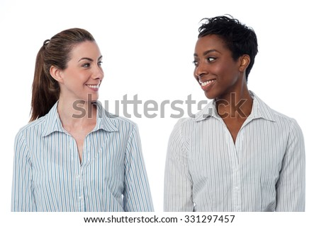 Two smiling business women isolated on white - stock photo
