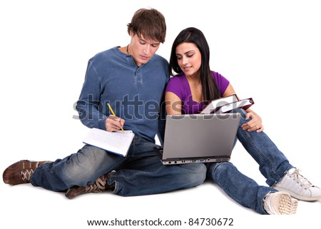 Two Smiling Casual Dressed College Student Working  on Isolated White Background - stock photo