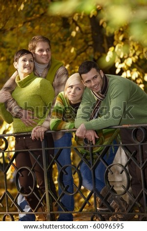 Two smiling couples on autumn walk in park.? - stock photo