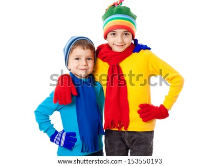 Two smiling kids in winter clothes together, isolated on white - stock photo