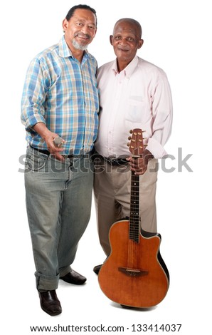 Two smiling old men pause for a moment with their guitar and microphone in rest mode. - stock photo