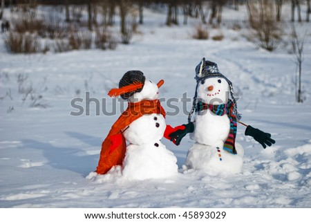 Two Snowmen - A lovely couple - stock photo