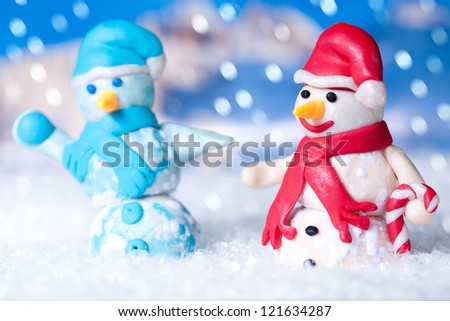 Two snowmen while Christmas time - stock photo