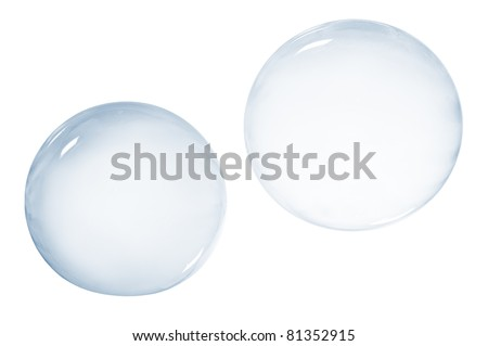 Two soap bubbles isolated on white background - stock photo