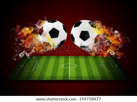 Two soccer balls in the color of flame and smoke. Sport concept - stock photo